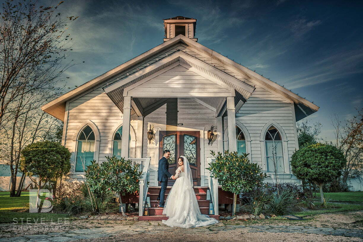 bride and groom in front of chapel in houston