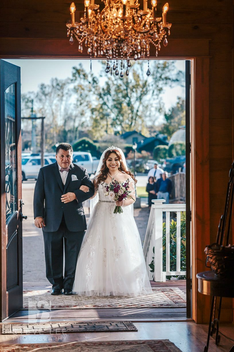 bride walking down aisle for wedding ceremony