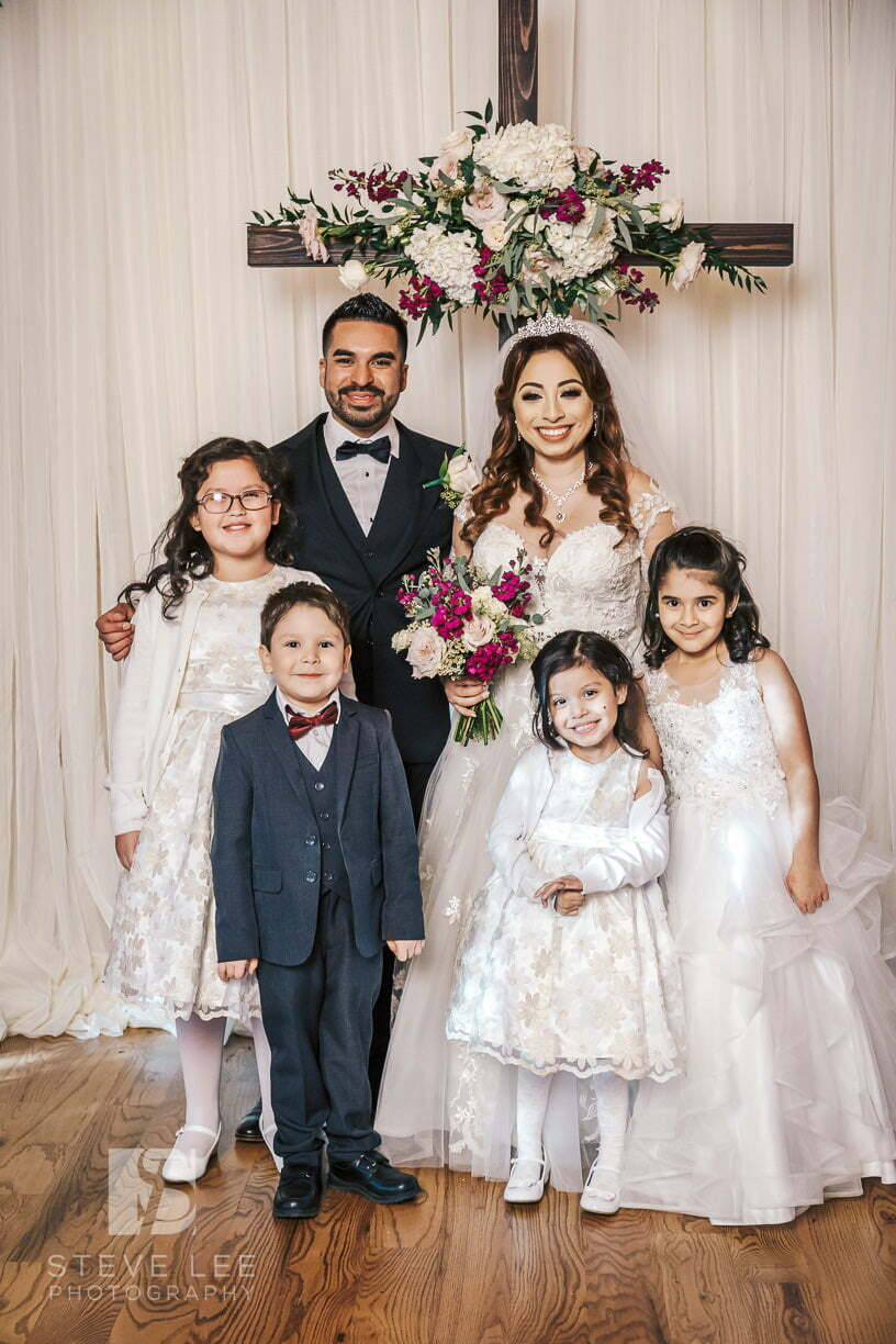 bride and groom and kids after wedding ceremony