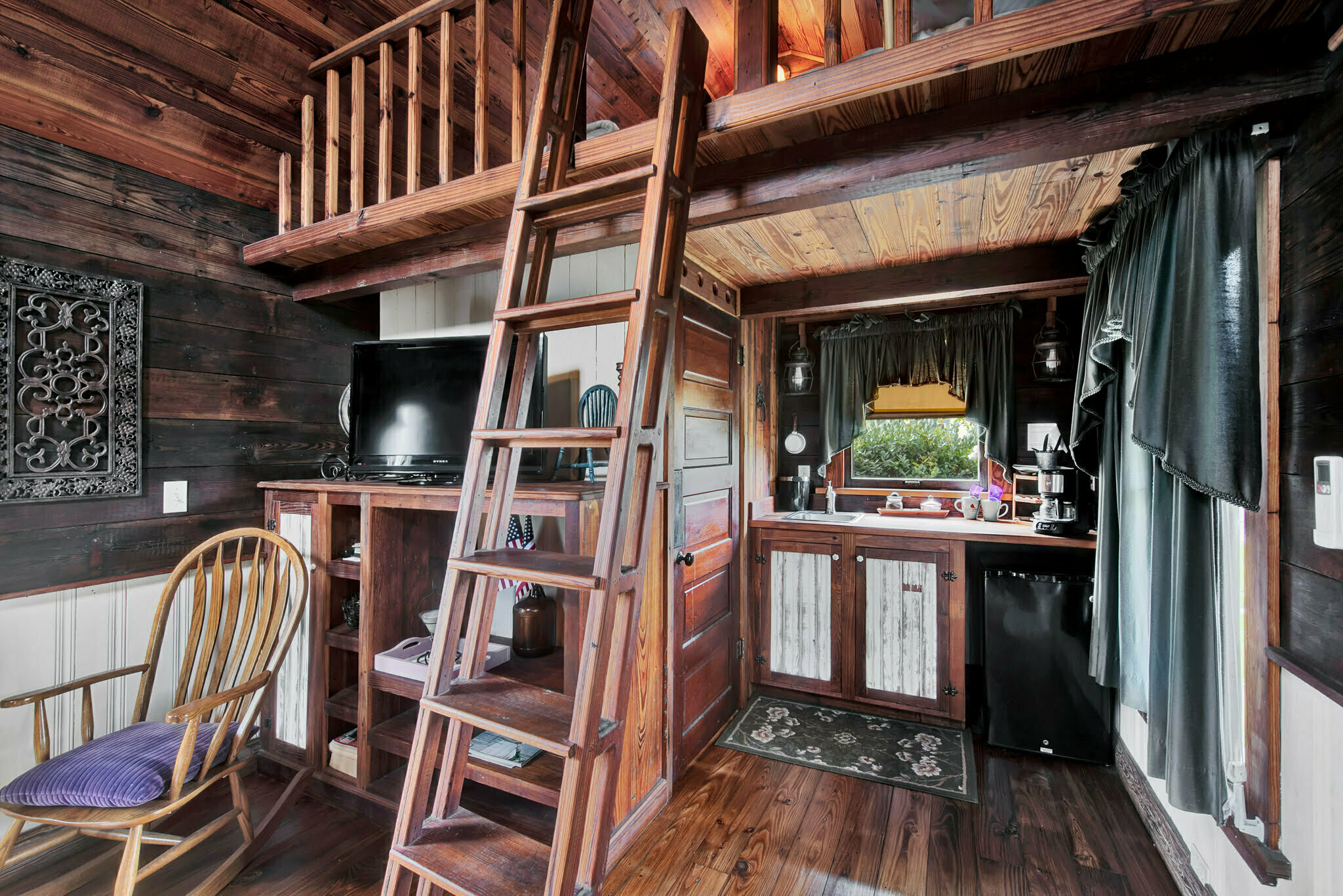 ladder to loft area of bed and breakfast