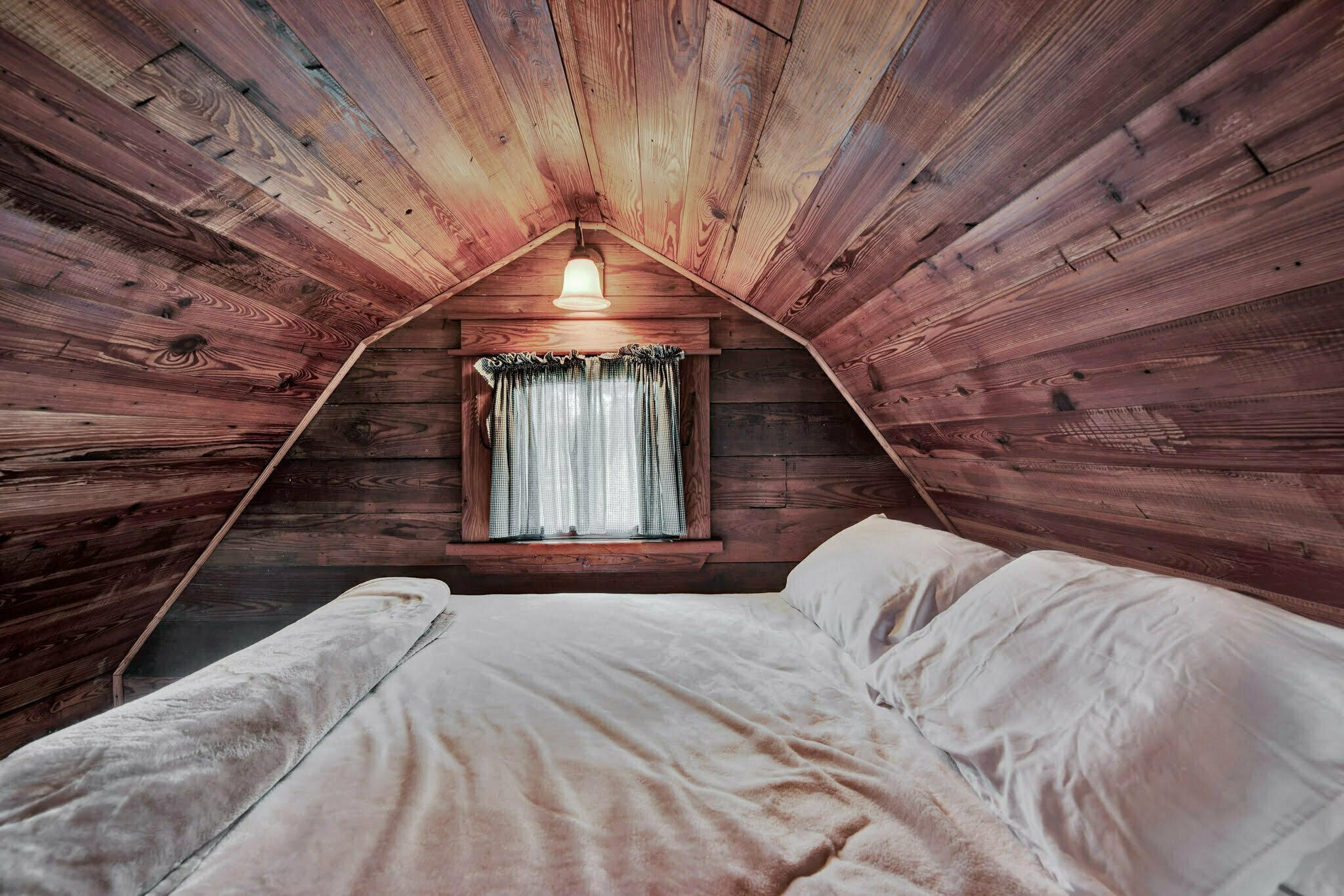 cozy bed in a loft