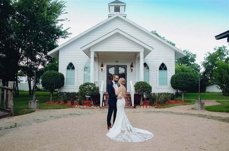 bride and groom in front of chapel at silver sycamore